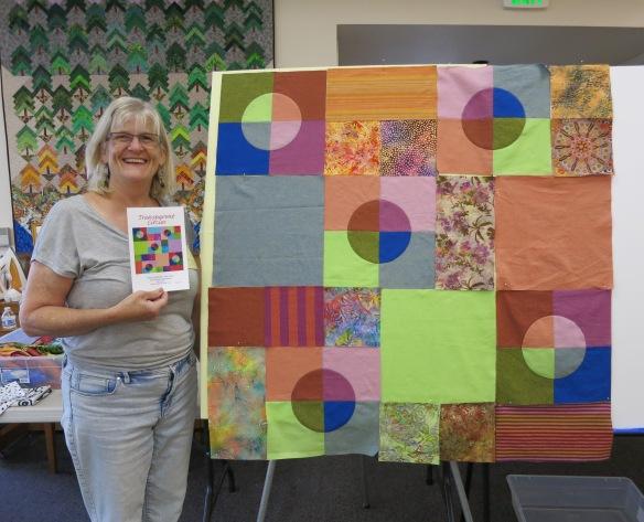 P Ellen with her quilt